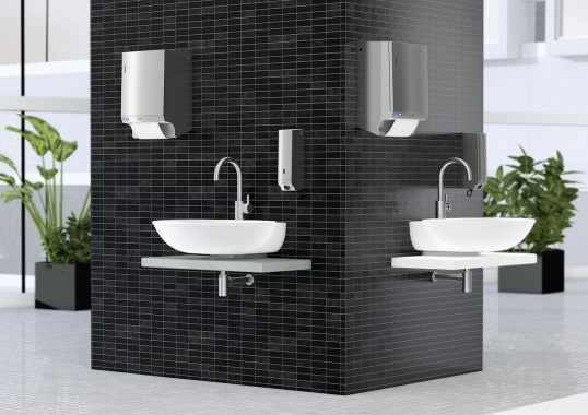 Trendfarben schwarz weiß grau - hier moderner Waschraum mit schwarzen Spenderelementen