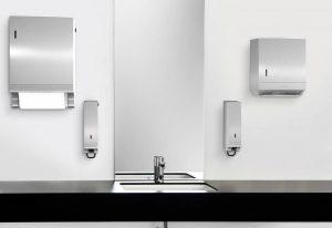 Abbildung eines Waschraums mit Spenderelementen in Edelstahl - Trendfarben